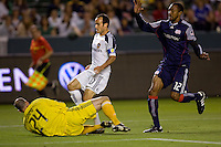 New England goalkeeper Preston Burpo makes a save from advancing LA Galaxy forward Landon Donovan. The LA Galaxy defeated the New England Revolution 1-0 at Home Depot Center stadium in Carson, California on Saturday evening March 27, 2010.  .