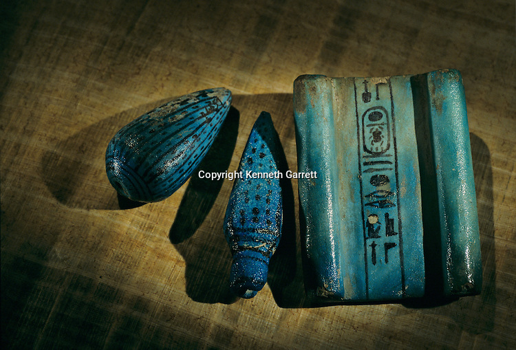 Faience model of Lotus bud, Floral Bud and papyrus, Amenhotep III, Tutankhamun and the Golden Age of the Pharaohs, Page 64, top