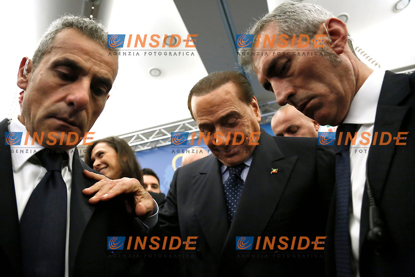 Silvio Berlusconi supported by two of his most trusty bodyguards<br /> Rome December 7th 2018. Convention of Forza Italia center-right party.<br /> Foto Samantha Zucchi Insidefoto
