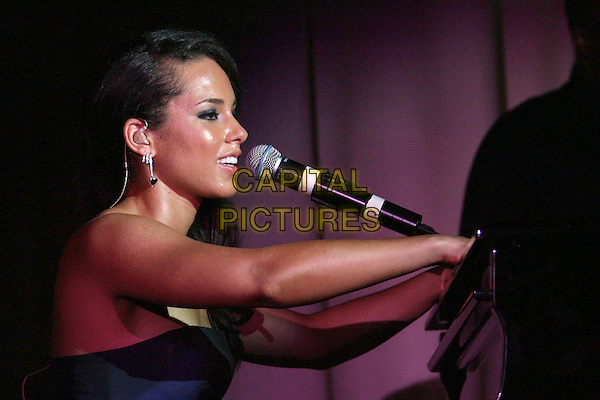 ALICIA KEYS.Performing at a private concert held at Club Nikki Chopard in the Carlton Hotel: 2006 Cannes International Film Festival, France, day 7.  .May 22nd, 2006.Photo: Zach Lipp/AdMedia/Capital Pictures.Ref: ZL/ADM.half length stage concert live gig performance music singing strapless .www.capitalpictures.com.sales@capitalpictures.com.© Capital Pictures.