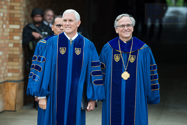 May 21, 2017; Commencement speaker Vice President Mike Pence and University of Notre Dame president Rev. John I. Jenkins, C.S.C., pause before entering Notre Dame Stadium for the 2017 Commencement ceremony.  (Photo by Barbara Johnston/University of Notre Dame)