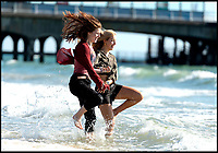 BNPS.co.uk (01202 558833)<br /> Pic: RogerArbon/BNPS<br /> <br /> Victoria Barinov (22) and Olympia Woellwarth (19).<br /> <br /> It's red hot October!<br /> <br /> Unseasonably warm weather draws people to Bournemouth beach to soak up the last of the summer rays.