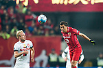 Shanghai FC Midfielder Akhmedov Odil (R) heads the ball during the AFC Champions League 2017 Group F match between Shanghai SIPG FC (CHN) vs Western Sydney Wanderers (AUS) at the Shanghai Stadium on 28 February 2017 in Shanghai, China. Photo by Marcio Rodrigo Machado / Power Sport Images