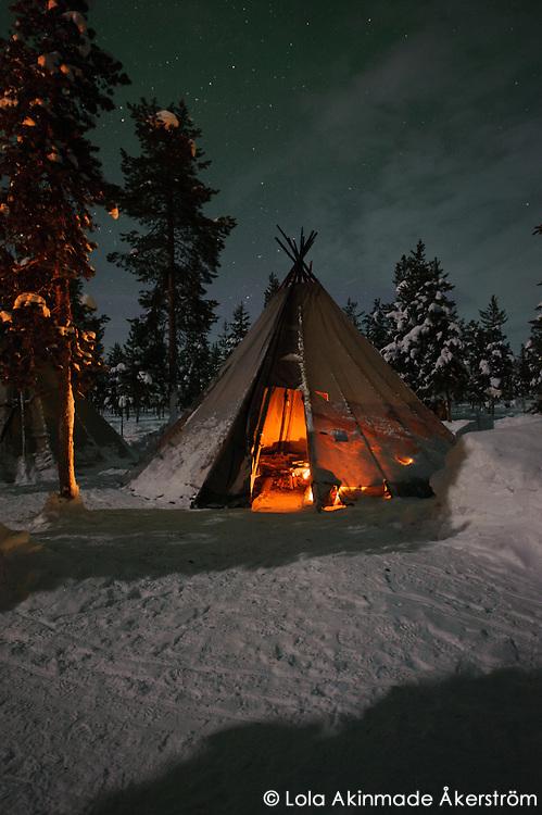 Aurora Borealis - Northern Lights over tent in Jukkasjärvi, Sweden