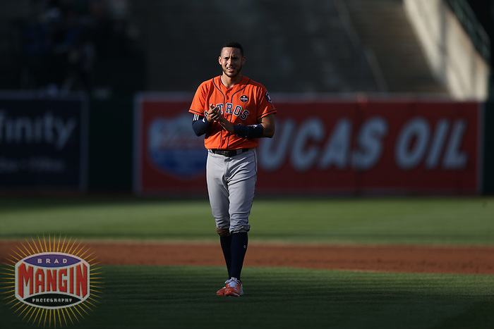 OAKLAND, CA - SEPTEMBER 9: Carlos Correa #1 of the Houston Astros stands on the field against the Oakland Athletics during game 2 of a doubleheader at the Oakland Coliseum on Saturday, September 9, 2017 in Oakland, California. (Photo by Brad Mangin)