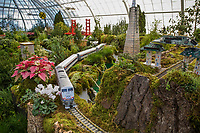 Model of Amtrak train in the garden railroad with models of Golden Gate Bridge, Transamerica building, and gates to Chinatown as part of the Golden Gate Express exhibit at San Franciso Conservatory of Flowers