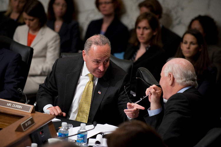 Sen. Charles Schumer, D-N.Y., left, talks with Sen. Ben Cardin, D-Md., during the Senate Judiciary Committee confirmation hearing on Supreme Court nominee Sonia Sotomayor, July 13, 2009.