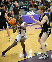Fayetteville's Bryson Wright (5) looks to shoot Friday, Jan. 17, 2020, as he is pressured by Bentonville's Connor Barnett during the first half of play in Bulldog Arena in Fayetteville. Visit nwaonline.com/prepbball/ for a gallery from the games.<br /> (NWA Democrat-Gazette/Andy Shupe)
