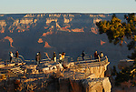 Visitors at sunrise on south rim