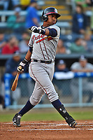 Rome Braves third baseman Carlos Franco #11 swings at a pitch during a game against the Asheville Tourists at McCormick Field on May 1, 2014 in Asheville, North Carolina. The Tourists defeated the Braves 8-7. (Tony Farlow/Four Seam Images)