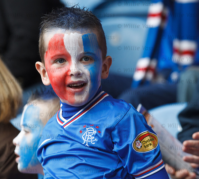 A young Rangers fan, facepainted and ready for a party