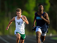 Sports action photography of the Woodlawn School track team in action at their meet at Stuart Cramer High School in Belmont, NC.<br /> <br /> Charlotte Photographer - PatrickSchneiderPhoto.com
