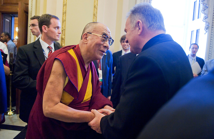 "UNITED STATES - JULY 07:  The Dalai Lama of Tibet, Tenzin Gyatso, greets Chaplain of the House Patrick Conroy, after a news conference in the Capitol's Rayburn Room with Speaker John Boehner, R-Ohio, House Minority Leader Nancy Pelosi, D-Calif., and other members of Congress.  Boehner remarked they discussed the Dalai Lama's shared values with the United States including ""freedom, tolerance and respect for human dignity."" (Photo By Tom Williams/Roll Call)"