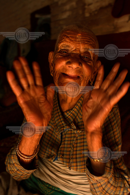 An elderly resident in the Pashupati Bridhashram (old peoples' home). Part of the Pashupatinath Temple complex, the old peoples' home is the largest of its type in Kathmandu, home to 140 women and 90 men. Nepal has a steadily growing elderly population.