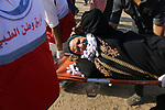 A wounded Palestinian protester is evacuated during clashes with Israeli troops following the tents protest where Palestinians demand the right to return to their homeland at the Israel-Gaza border, in Khan Younis in the southern Gaza Strip, August 16, 2019. Photo by Mariam Dagga