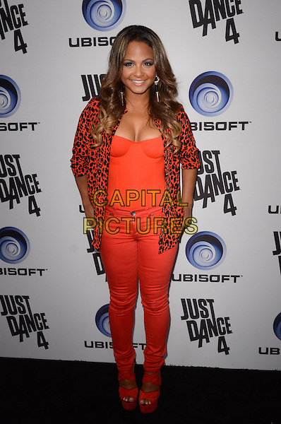 Christina Milian.Ubisoft Presents The Launch Of Just Dance 4  held at Lexington Social House, Hollywood, California, USA..October 2nd, 2012.full length red orange leopard print blazer corset top cleavage jeans denim hands on hips  shoes .CAP/ADM/TW.©Tonya Wise/AdMedia/Capital Pictures.