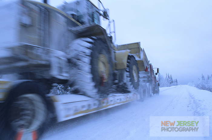 Truck trasporting heavy equipment on the James Dalton Highway, Brooks Range, Alaska