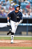 Asheville Tourists center fielder Manny Melendez (19) runs to first base during a game against the Greenville Drive at McCormick Field on April 13, 2017 in Asheville, North Carolina. The Tourists defeated the Drive 3-1. (Tony Farlow/Four Seam Images)