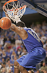 UK guard John Wall dunks to end the Blue and White scrimmage at Rupp Arena Wednesday night..Photo by Zach Brake | Staff