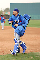 Geovany Soto #18 of the Chicago Cubs arrives on the field during spring training workouts at the Cubs complex on February 19, 2011  in Mesa, Arizona. .Photo by Bill Mitchell / Four Seam Images.