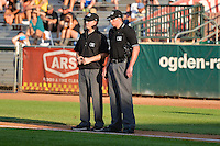 Home plate umpire Aaron Higgins and base umpire Ryan Powers during the game between the Ogden Raptors and the Idaho Falls Chukars in Pioneer League action at Lindquist Field on July 26, 2014 in Ogden, Utah. (Stephen Smith/Four Seam Images)