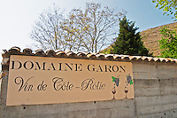 Domaine Garon Vin de Cote Rotie, painted sign with vineyards in the background. Ampuis, Cote Rotie, Rhone, France, Europe