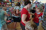 Emma Moody, 9,  doesn't agree with her mother, Christa Moody, about how to spend her own money at the Learning Express.