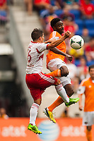 Warren Creavalle (5) of the Houston Dynamo goes up for a header with Connor Lade (16) of the New York Red Bulls. The New York Red Bulls defeated the Houston Dynamo 2-0 during a Major League Soccer (MLS) match at Red Bull Arena in Harrison, NJ, on June 30, 2013.
