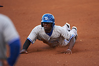 Dunedin Blue Jays D.J. Davis (6) slides into third base during a game against the Tampa Yankees on April 19, 2016 at George M. Steinbrenner Field in Tampa, Florida.  Tampa defeated Dunedin 12-7.  (Mike Janes/Four Seam Images)