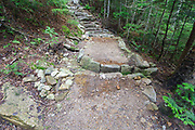 Fresh dirt has been placed around stone work on the Mt Tecumseh Trail in Waterville Valley, New Hampshire during the summer months.