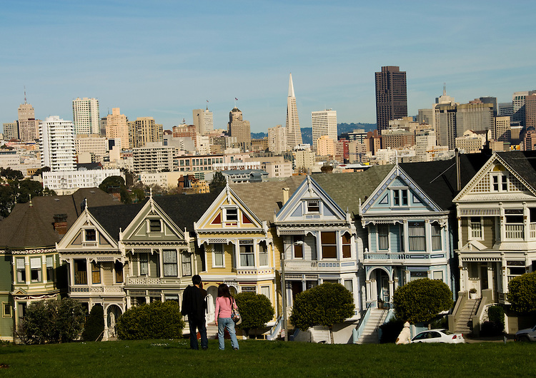 California: San Francisco. People relaxing in Alamo Square with view of Victorians and modern downtown. Photo copyright Lee Foster. Photo #: san-francisco-alamo-square-20-casanf77515