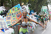 London, UK. 25 August 2014. Performers from the London School of Samba. Visitors and participants of the Notting Hill Carnival 2014 Bank Holiday Monday parade got soaked to their skin, but the weather couldn't dampen the revellers spirit - although many spectators stayed away.