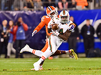 Charlotte, NC - DEC 2, 2017: Miami Hurricanes wide receiver Jeff Thomas (4) is defended by Clemson Tigers defensive back K'Von Wallace (12) during ACC Championship game between Miami and Clemson at Bank of America Stadium Charlotte, North Carolina. (Photo by Phil Peters/Media Images International)