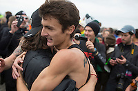 Colorado's Blake Theroux (93) shares a hug in celebration of the team's title during the NCAA Cross Country Championships in Terre Haute, Ind. on Saturday, Nov. 22, 2014. (James Brosher, Special to the Denver Post)