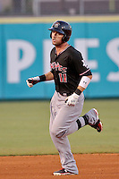 Albuquerque Isotopes right fielder Kyle Parker (11) rounds the bases after hitting a solo homerun against the New Orleans Zephyrs in a game at Zephyr Field on May 28, 2015 in Metairie, Louisiana. (Derick E. Hingle/Four Seam Images)