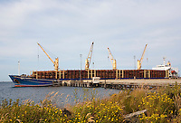 Log Exports, ironically on a ship named after magnificant Mt. Rainier and on the border of Olympic National Park.  Port Angeles, Olympic Penninsula, Washington.  Outdoor Adventure. Olympic Peninsula