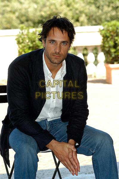 "RAOUL BOVA.Photcall for the film ""Io, l'altro"", Campidoglio, Rome, Italy..May 10th, 2007.half length sitting blue jacket  .CAP/CAV.©Luca Cavallari/Capital Pictures"