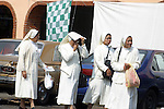FOUR NUNS WAITING FOR RIDE ON MEXICAN STREET(2)