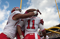 Luke Matthews (11) gets hugs after scoring a touchdown. The Utah Utes defeated the Pitt Panthers 26-14 at Heinz Field, Pittsburgh, Pennsylvania on October 15, 2011.