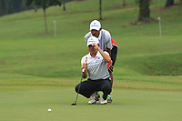 Nicholas Fung (Asia) on the 8th green during the Saturday Foursomes of the Eurasia Cup at Glenmarie Golf and Country Club on the 13th January 2018.<br /> Picture:  Thos Caffrey / www.golffile.ie