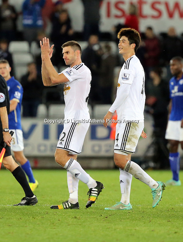 Pictured L-R: Angel Rangel of Swansea with team mate Ki SUng Yueng. Saturday 25 October 2014<br />