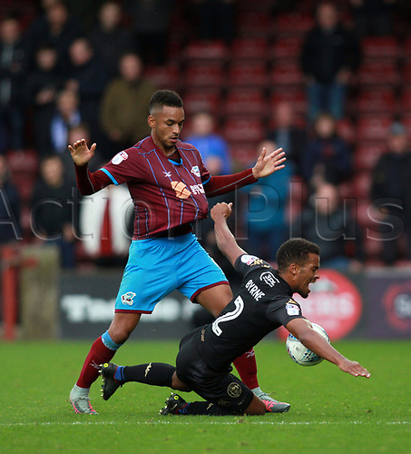 7th October 2017, Glanford Park, Scunthorpe, England; EFL League One football, Scunthorpe versus Wigan; Nathan Byrne of Wigan Athletic is fouled by Funso Ojo of Scunthorpe United late in the 1-2 win for Wigan