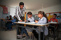 "Palestinian children are seen at  Jenba's school in the South Hebron Hills, Jenba a Palestinian town of 50 families seats in an area called by the IDF as ""Firing Zone 918"" and is located in the southern Hebron hills near the town of Yatta.  Spread over 30,000 dunams, it includes twelve Palestinian villages.  According to OCHA figures, 1,622 people lived in the area in 2010, and according to local residents the number of inhabitants currently stands at about 1,800. For over a decade, the residents of twelve uniquely traditional Palestinian villages in the area of Masafer-Yatta in the south Hebron hills have lived under the constant threat of demolition, evacuation, and dispossession.<br />