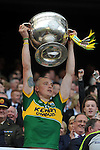 Kieran Donaghy lifts the Sam Maguire Cup to celebrate  Kerry's victory over Donegal in the All-Ireland Football Final against  in Croke Park 2014.<br /> Photo: Don MacMonagle<br /> <br /> <br /> Photo: Don MacMonagle <br /> e: info@macmonagle.com