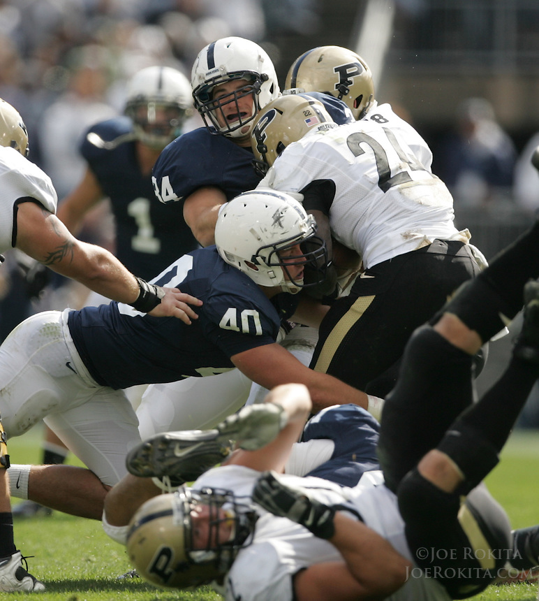 State College, PA - 10/15/2011:  Penn State linebackers Nate Stupar (34) and Glenn Carson (40) stop Purdue RB Akeem Shavers.  Stupar and Carson each had 7 tackles during the game.  Penn State defeated Purdue by a score of 23-18 on October 15, 2011, homecoming, at Beaver Stadium...Photo:  Joe Rokita / JoeRokita.com..Photo ©2011 Joe Rokita Photography