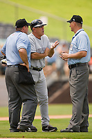 Louisville Bats manager Rick Sweet #16 argues a call with first base umpire Justin Vogel (right) and home plate umpire Craig Barron during an International League game against the Charlotte Knights at Knights Stadium July 20, 2010, in Fort Mill, South Carolina.  Photo by Brian Westerholt / Four Seam Images