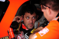 Sept. 20, 2008; Dover, DE, USA; Nascar Sprint Cup Series driver Tony Stewart talks to a crew member during practice for the Camping World RV 400 at Dover International Speedway. Mandatory Credit: Mark J. Rebilas-
