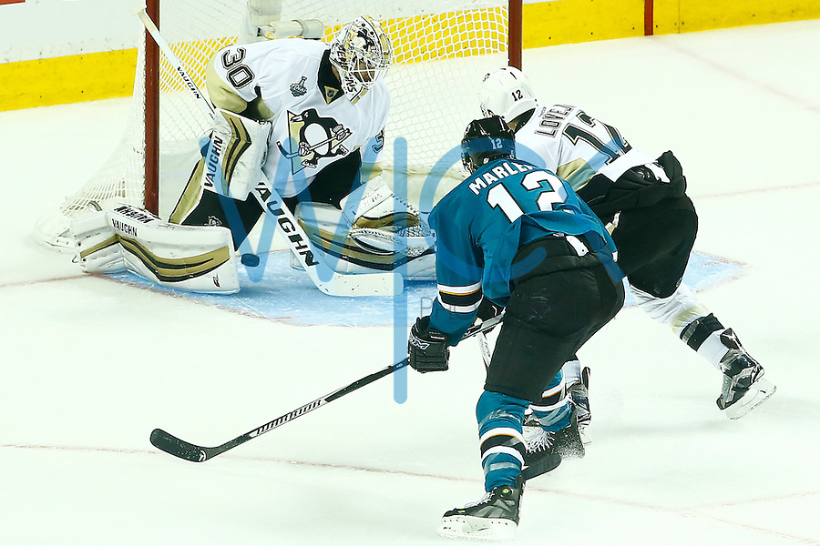 Matt Murray #30 of the Pittsburgh Penguins makes a save on a shot by Patrick Marleau #12 of the San Jose Sharks during game three of the Stanley Cup Final at the SAP Center in San Jose, California on June 4, 2016. (Photo by Jared Wickerham / DKPS)