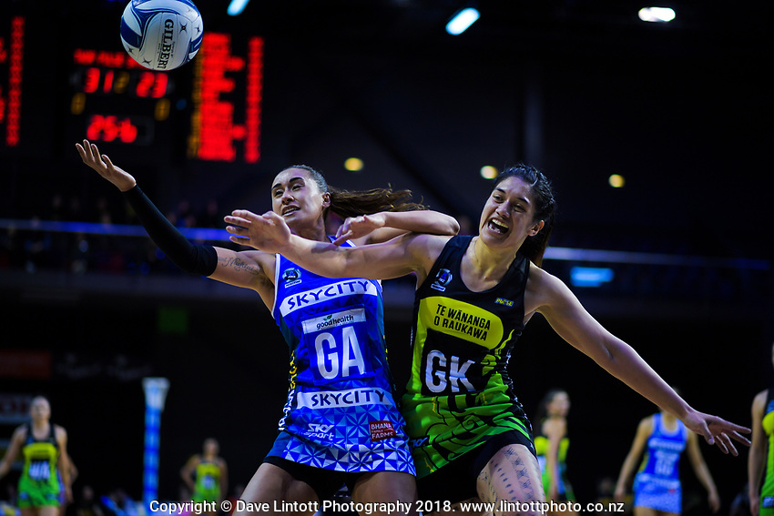 Maria Folau (left) and Sulu Fitzpatrick compete for the ball during the ANZ Premiership netball match between the Central Pulse and Northern Mystics at TSB Bank Arena in Wellington, New Zealand on Wednesday, 1 August 2018. Photo: Dave Lintott / lintottphoto.co.nz