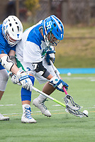 Salve's Jake Gonzalez,'17, battles Roger Williams for posession during the Men's Lacrosse game action at Gaudet Field in Middletown.
